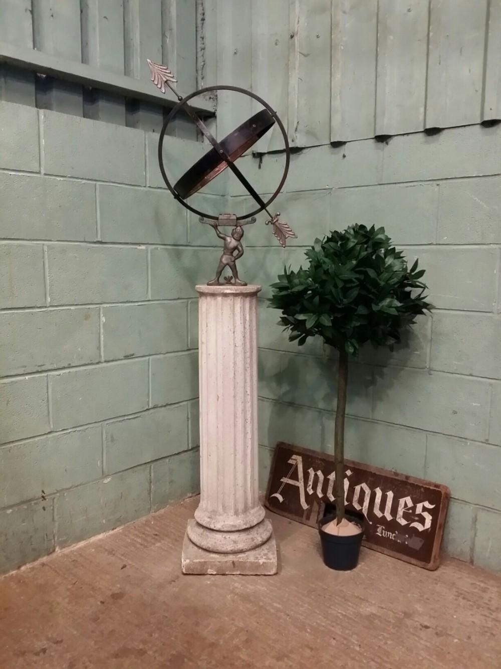 amillary sphere and stone sundial c1950