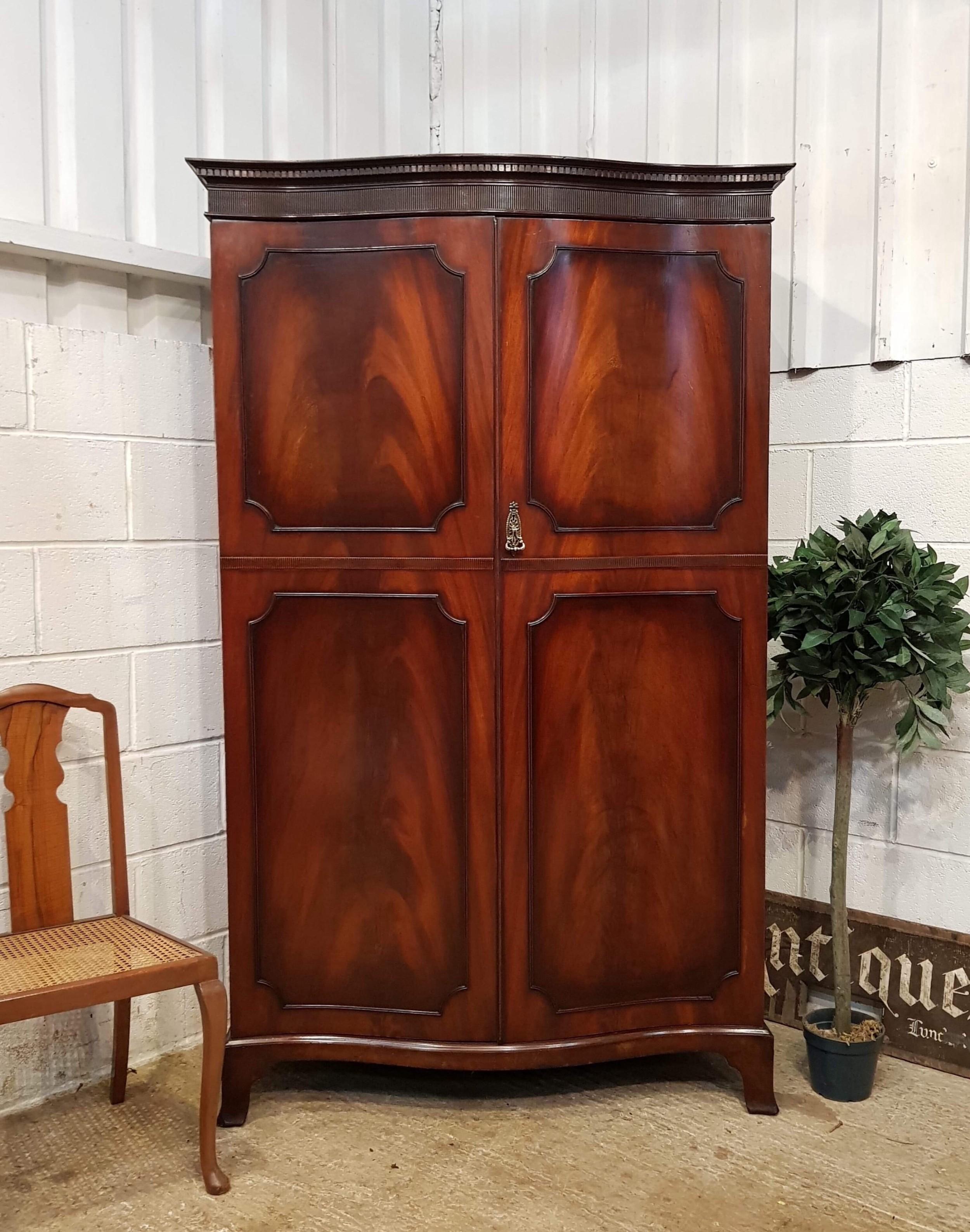 antique edwardian flamed mahogany serpentine shaped double wardrobe c1900