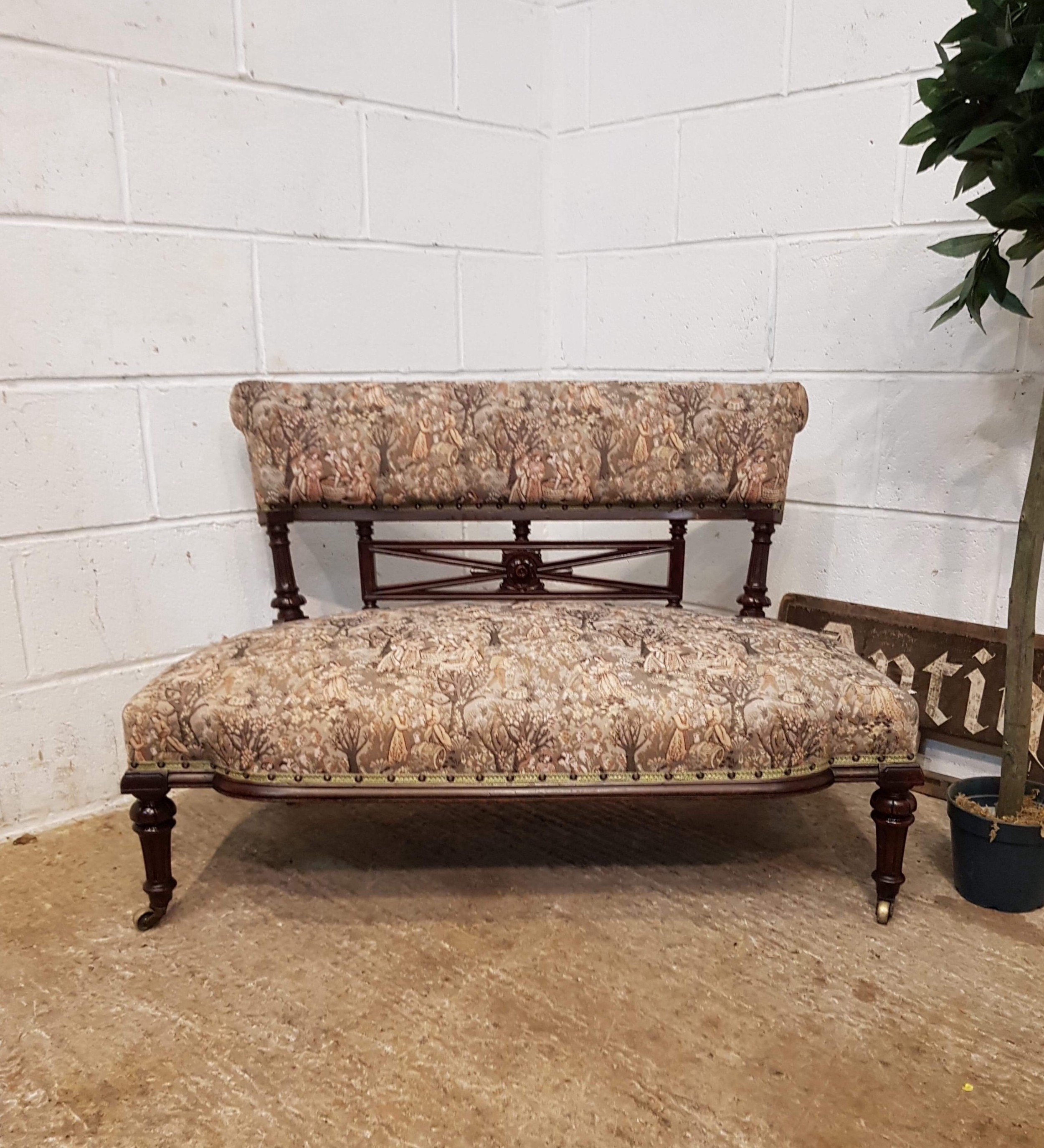 antique small french mahogany serpentine shaped sofa c1900