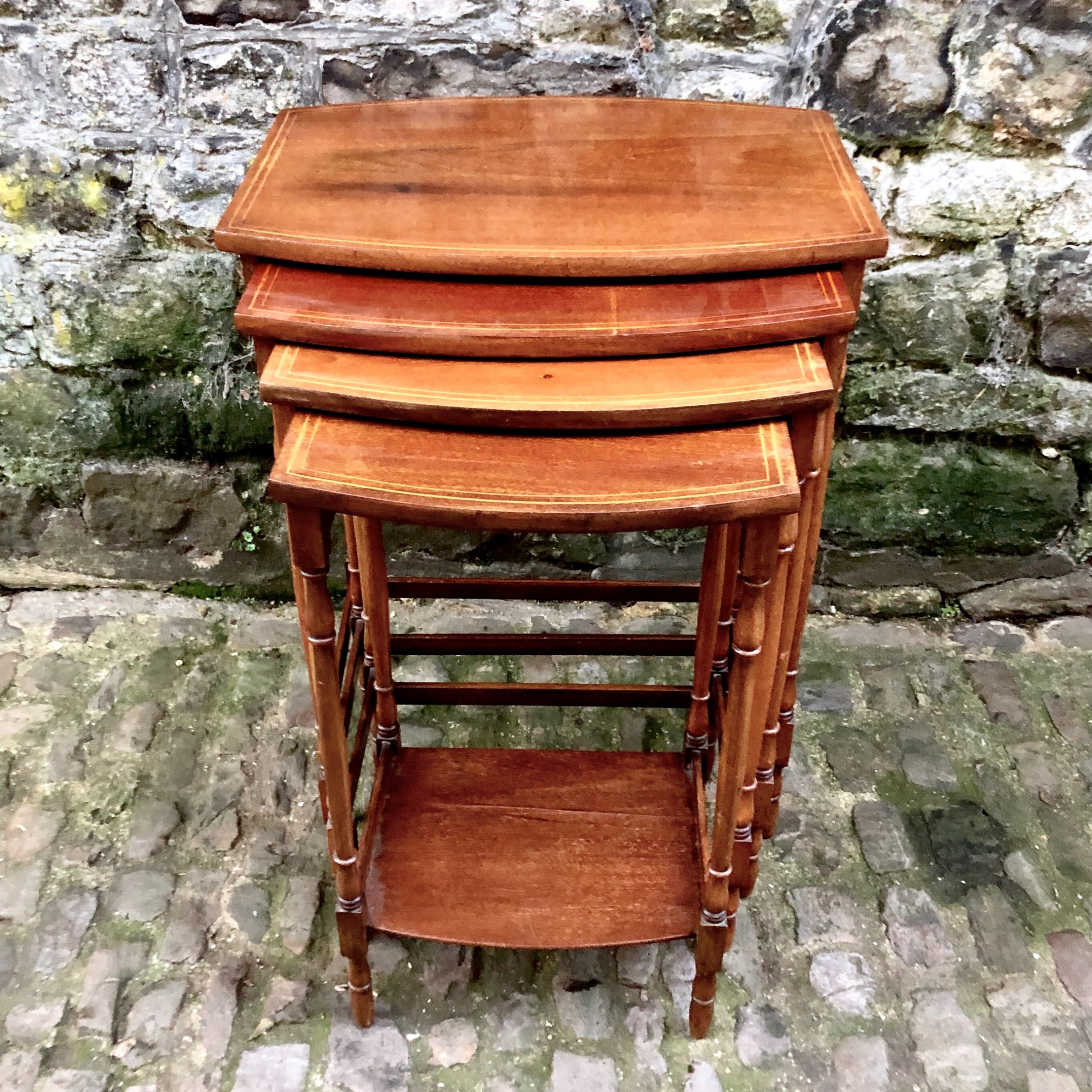 an edwardian nest of four mahogany side tables