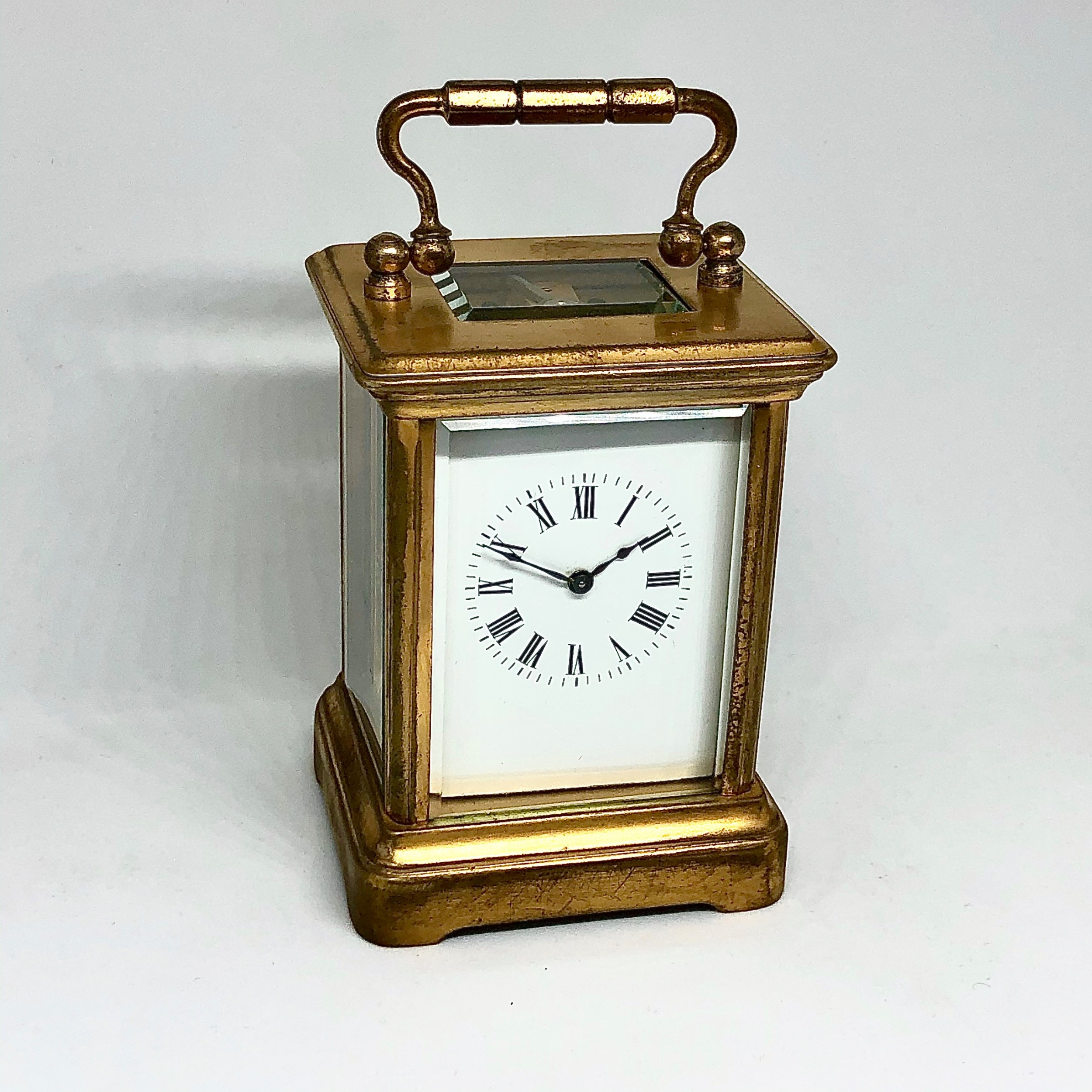 a late 19th century miniature french gilt brass carriage clock timepiece