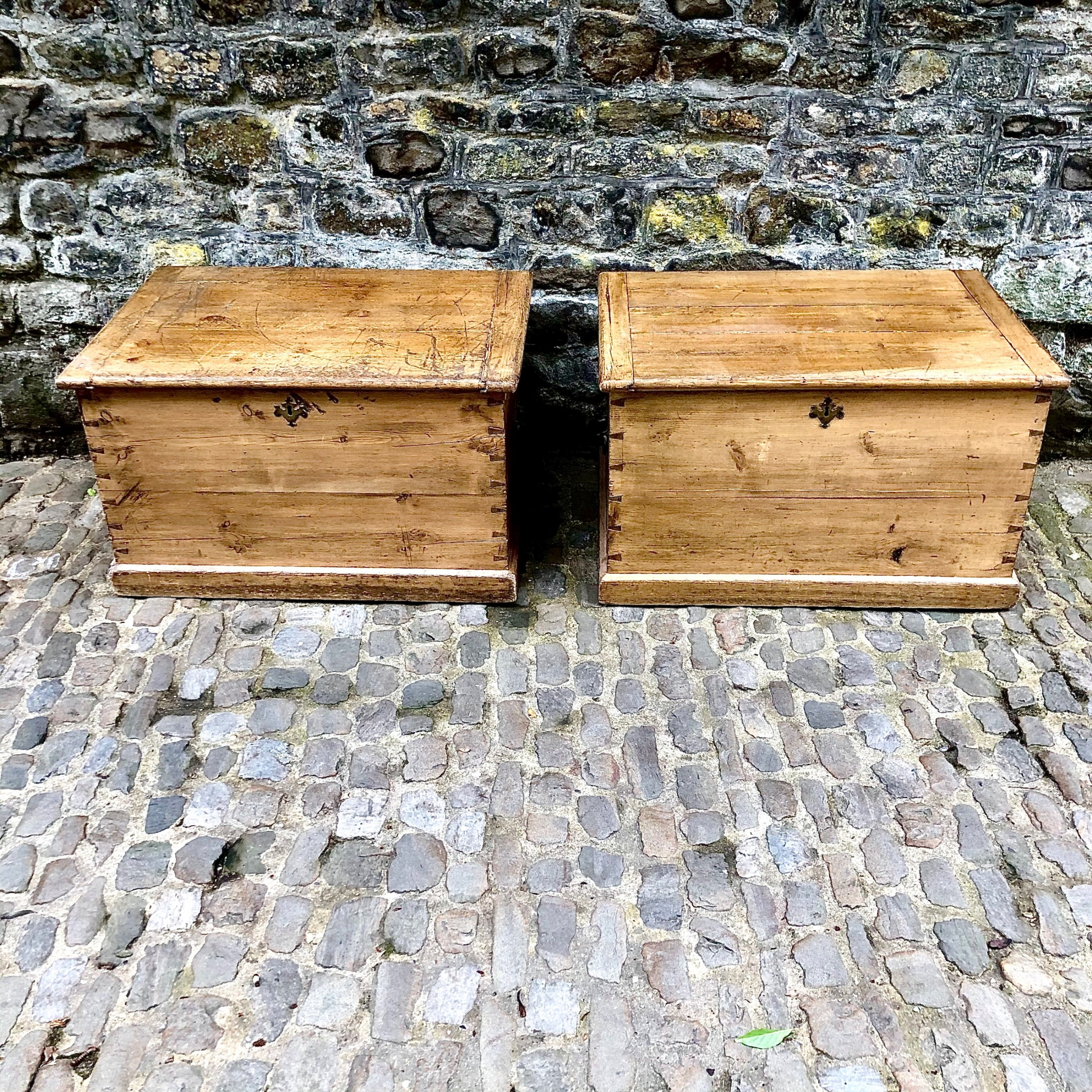 a pair of early 19th century pine blanket boxes or sailors trunks