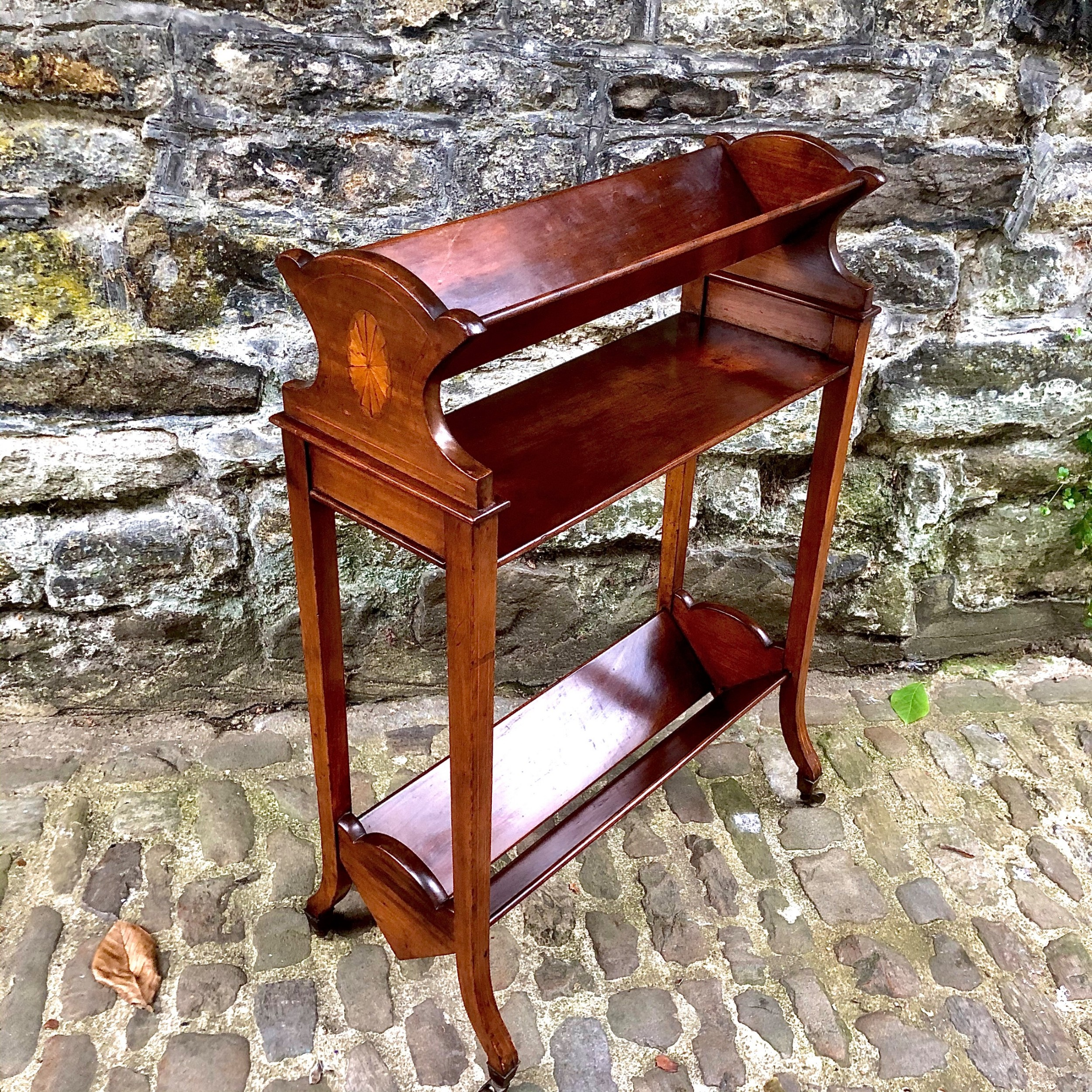 an edwardian mahogany two tier book trough