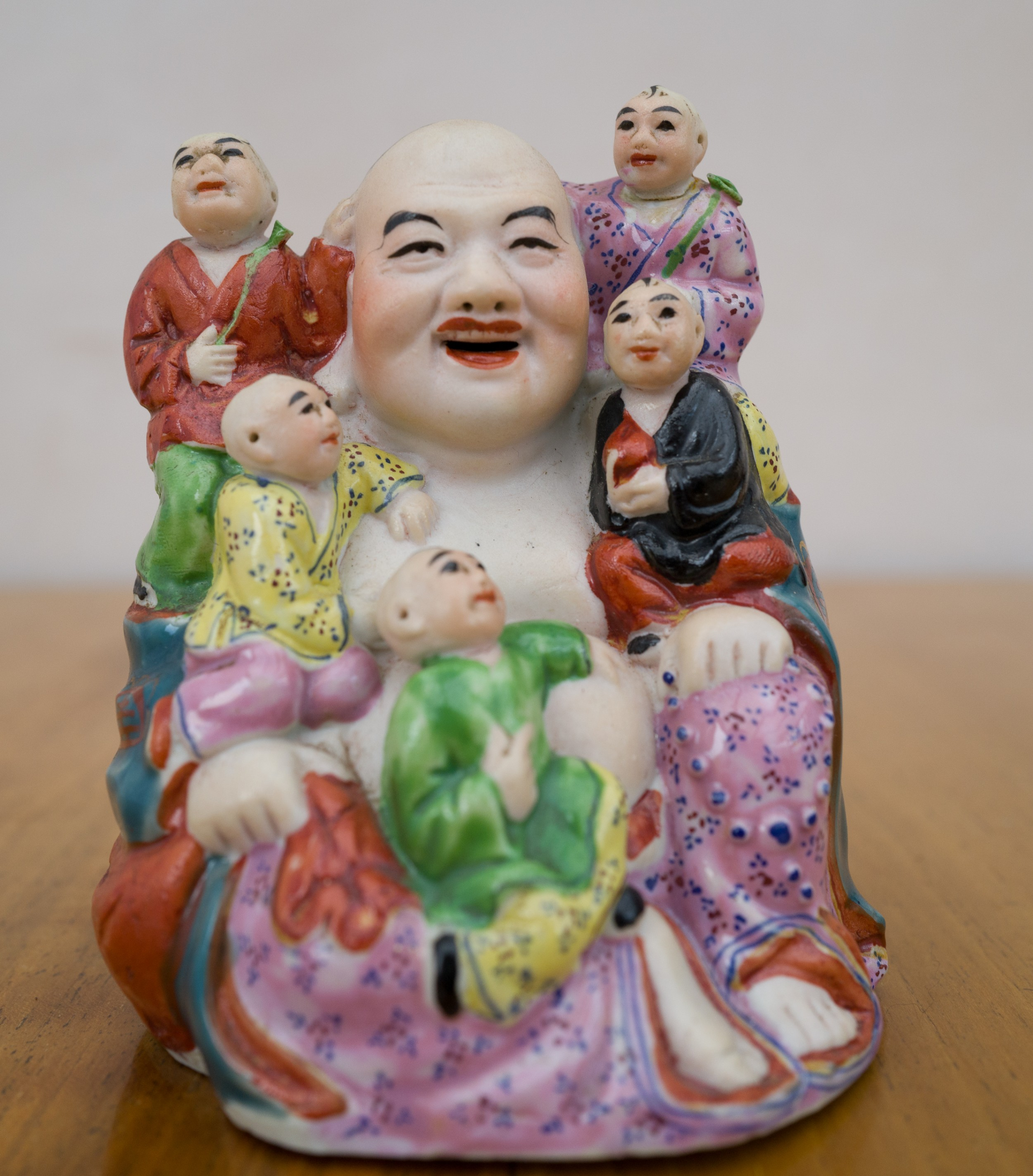 seated chinese buddha with 5 boys