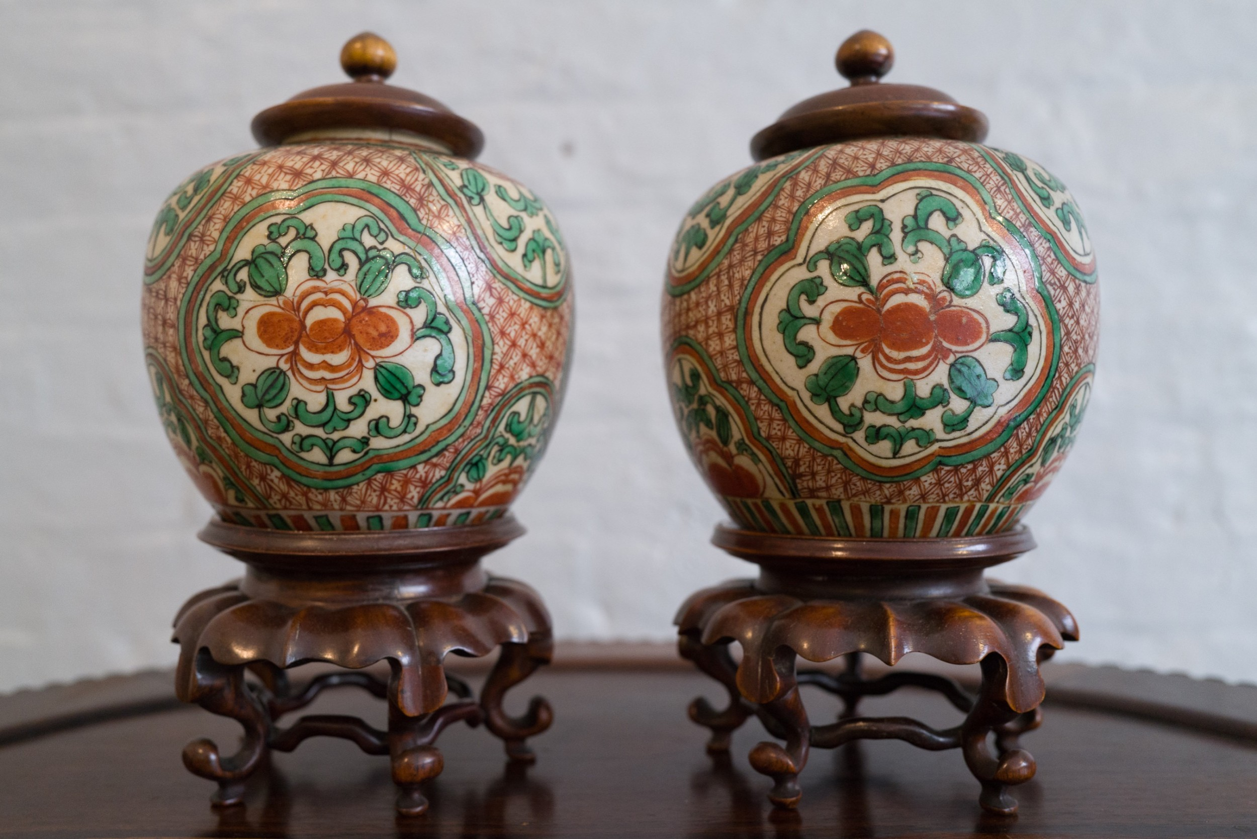 pair of chinese jars with hong mu stands and lids