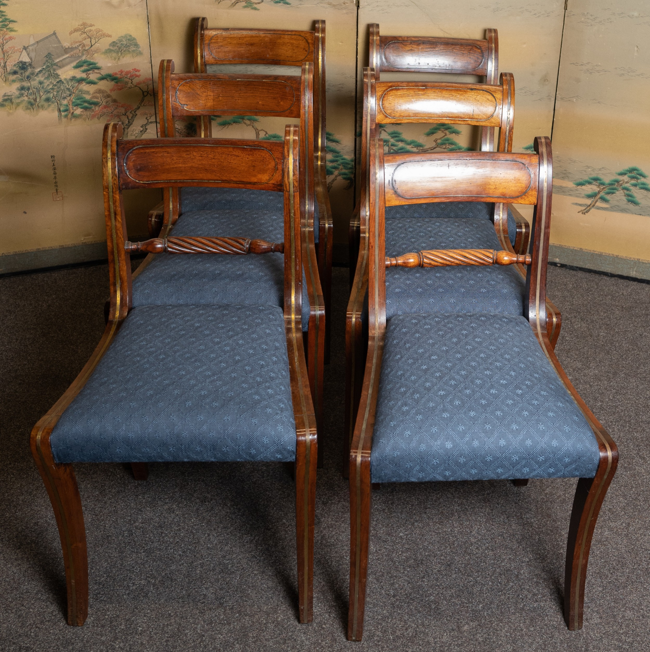 a good quality set 6 of rosewood sabre leg chairs