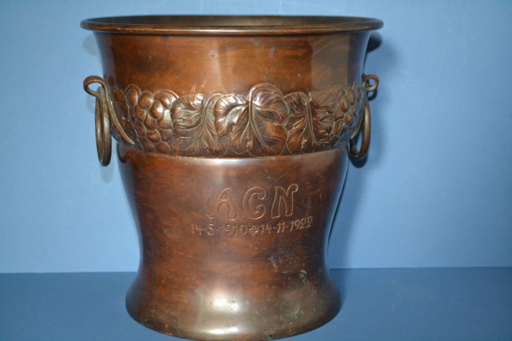 bronze patinated copper ice bucket1922presentation piece inscribed 'a c n 14510 14111922