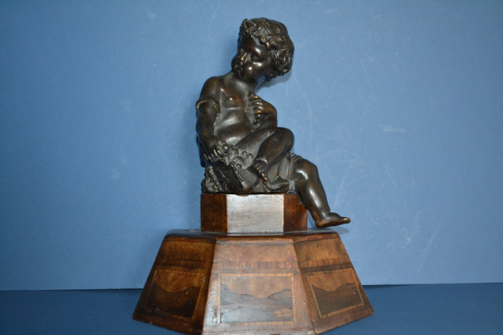 19th century bronze seated putti on inlaid wood base c 1870