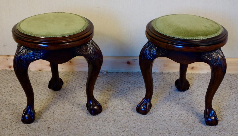 pair of carved mahogany stools