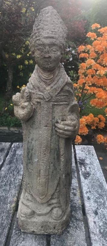 stone carving of a bishop