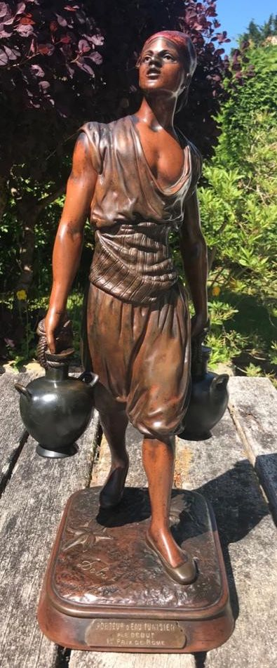 bronze sculpture of a water carrier by debut