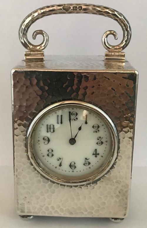cased silver travel clock