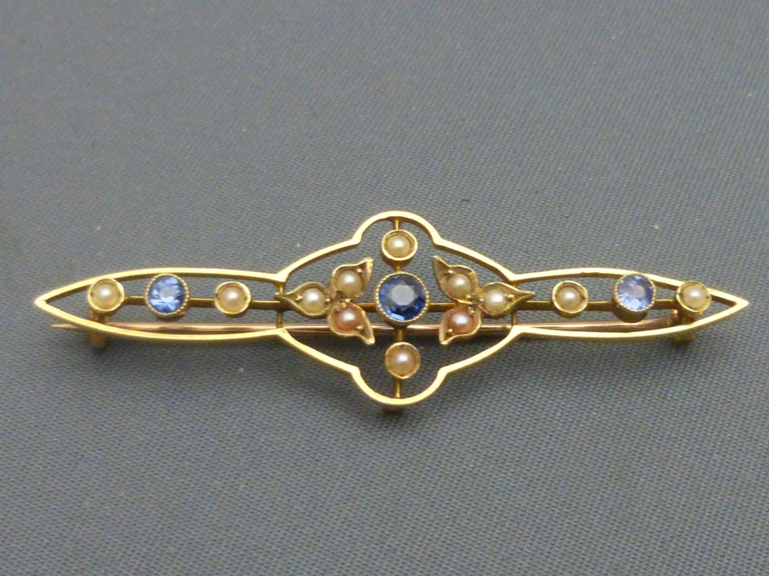 edwardian 15ct goldsapphire and pearl set brooch