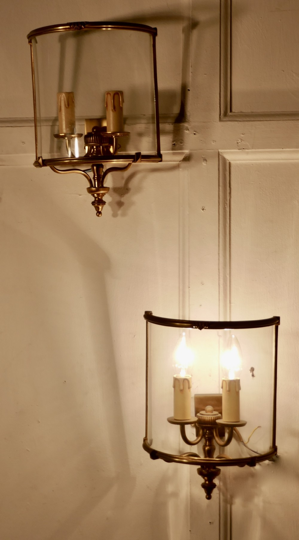 a pair of french twin light brass convex wall lanterns