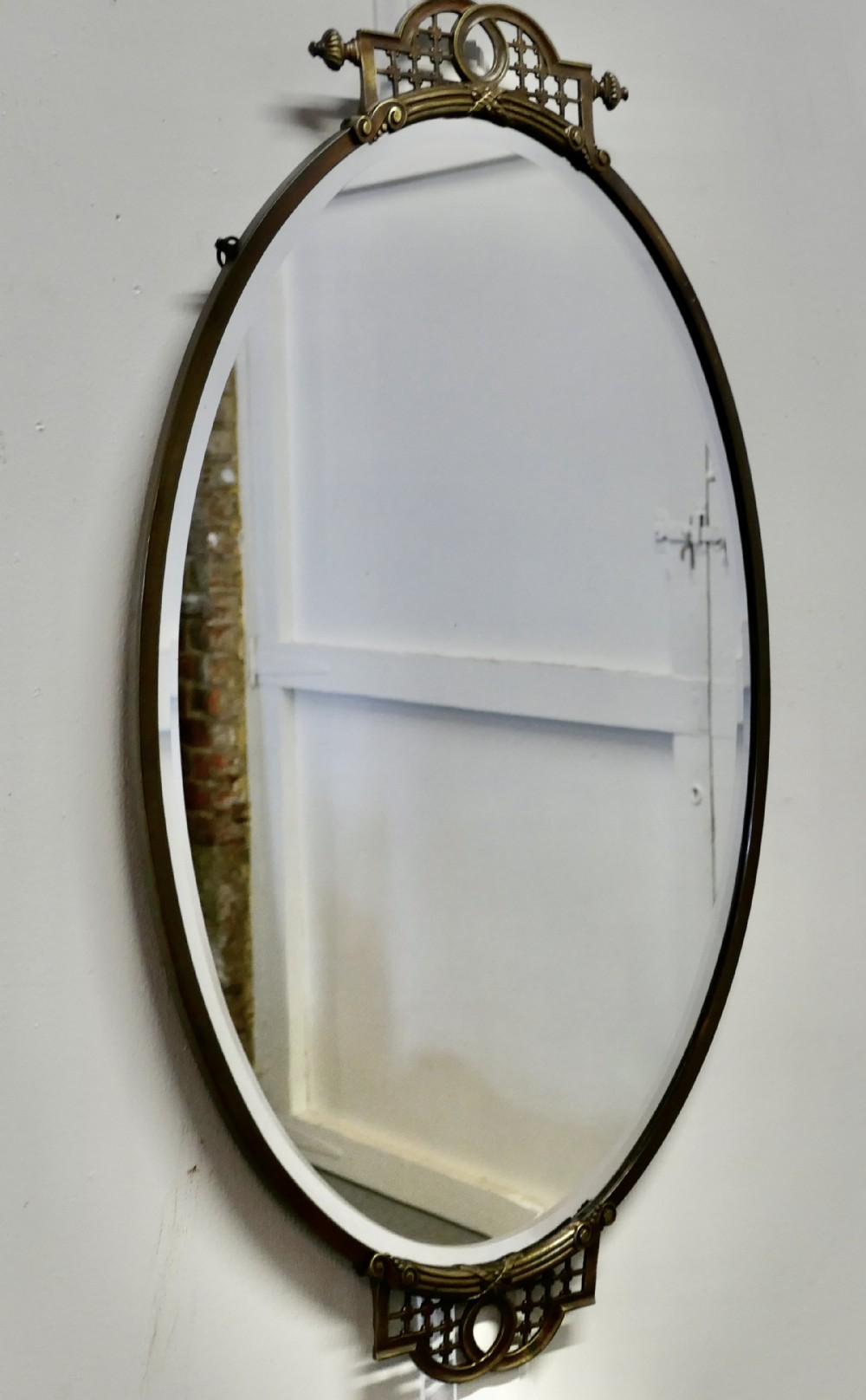 long oval art deco brass wall mirror