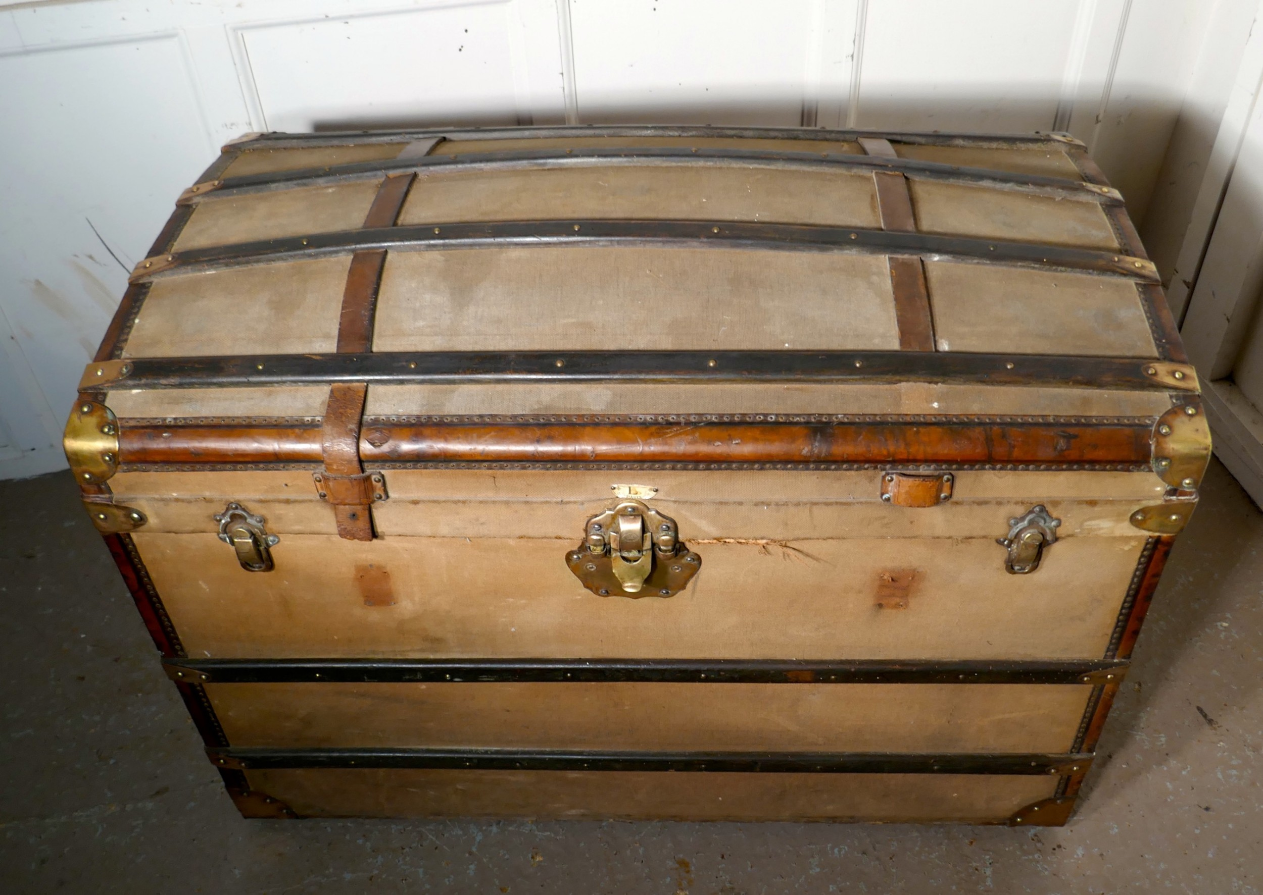 a large 19th century french canvas dome top travel trunk lion brand