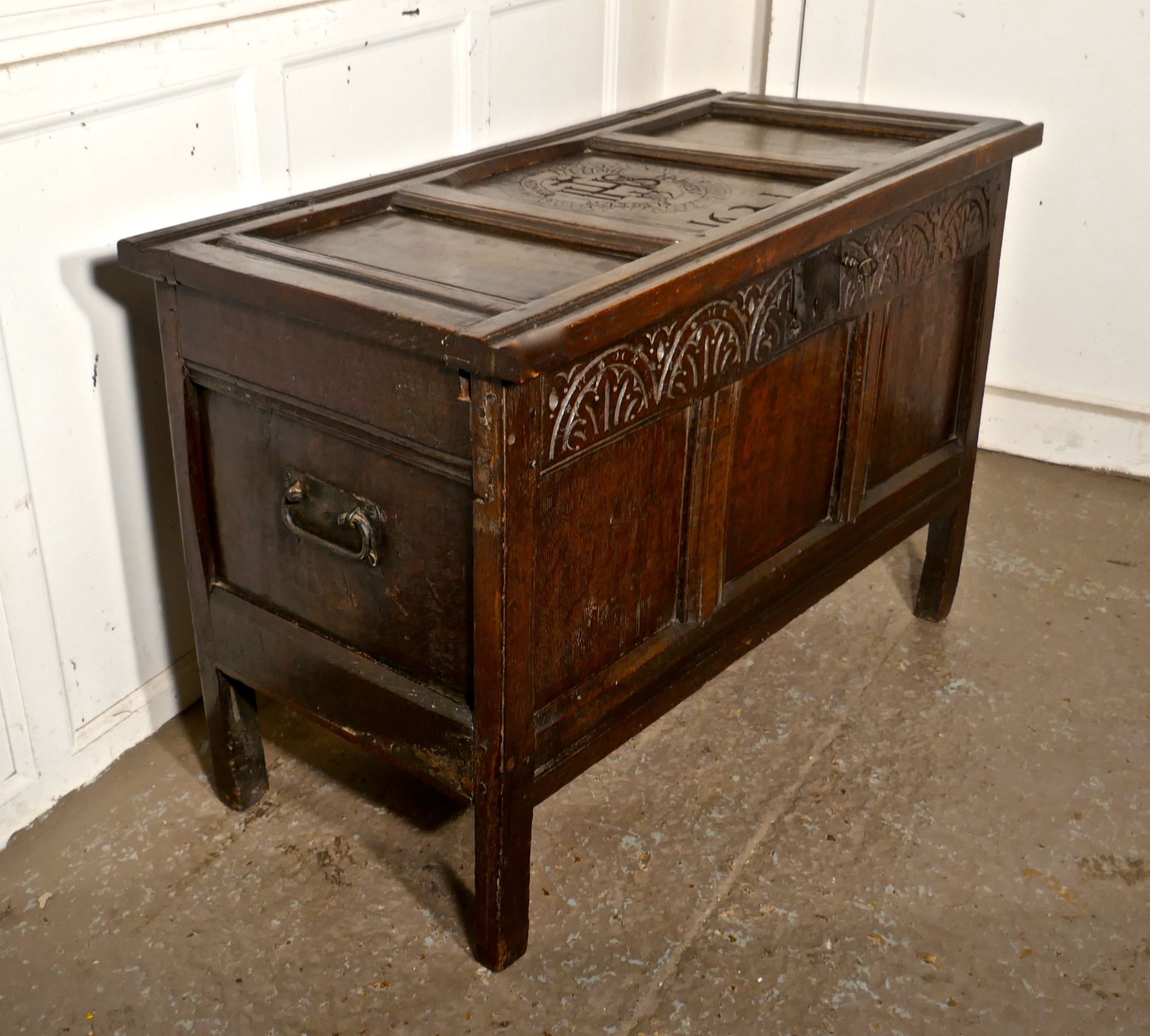 a small early 17th century carved oak coffer 1621