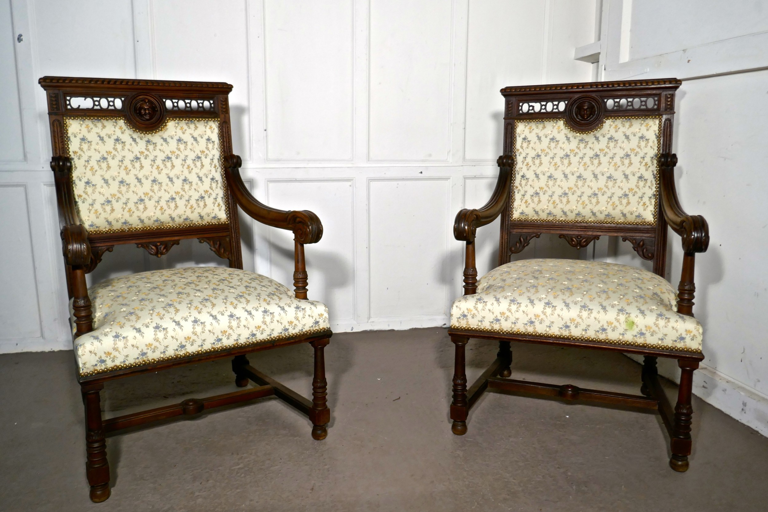 a pair of french gothic walnut library throne chairs