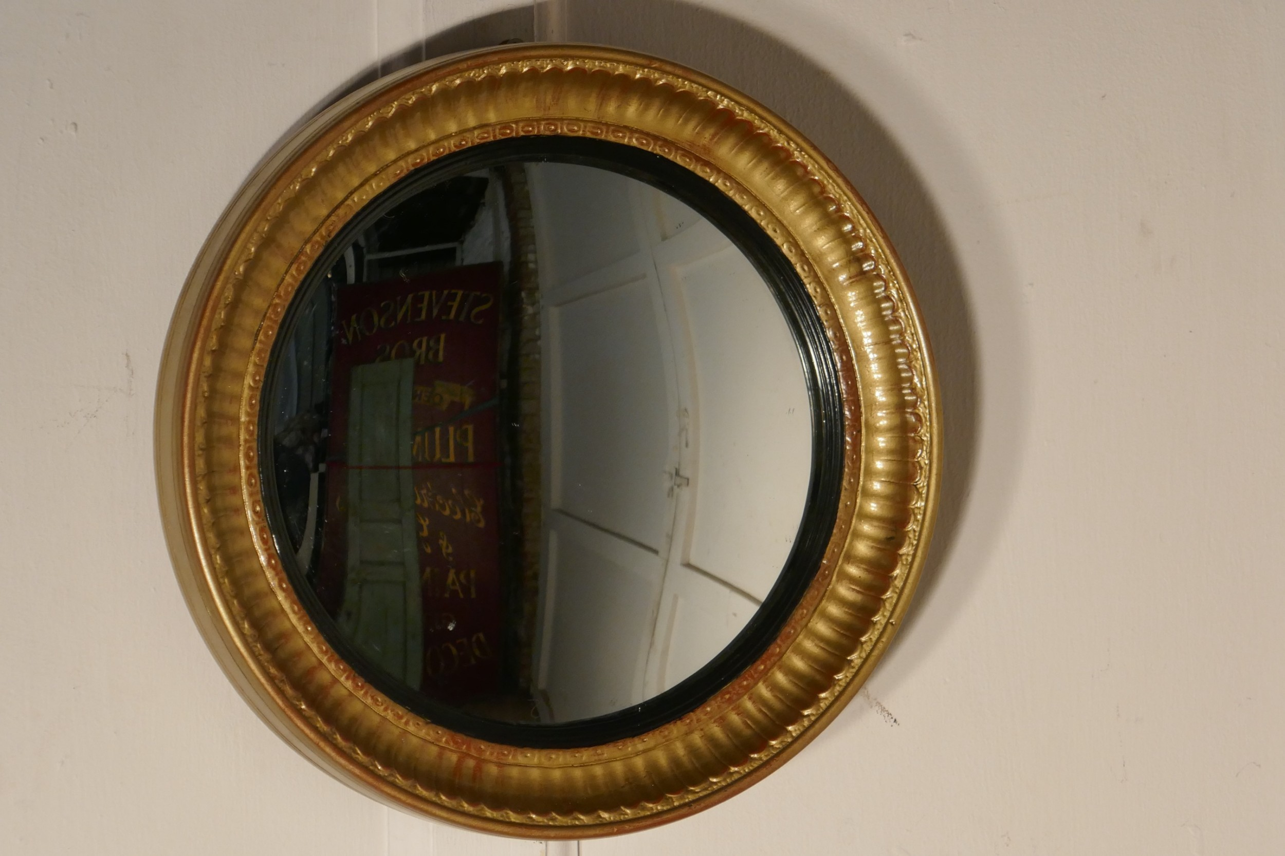 small round frame gilt convex wall mirror