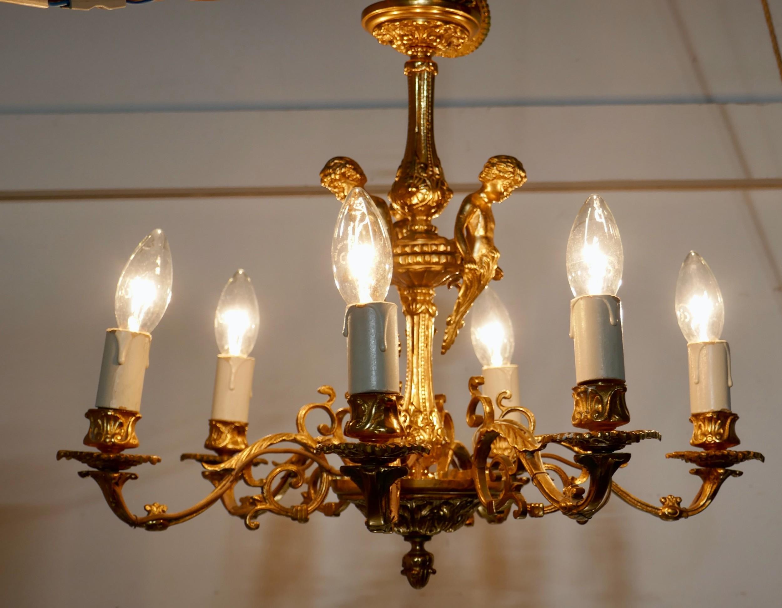 a french gilded brass 6 branch rococo cherub chandelier