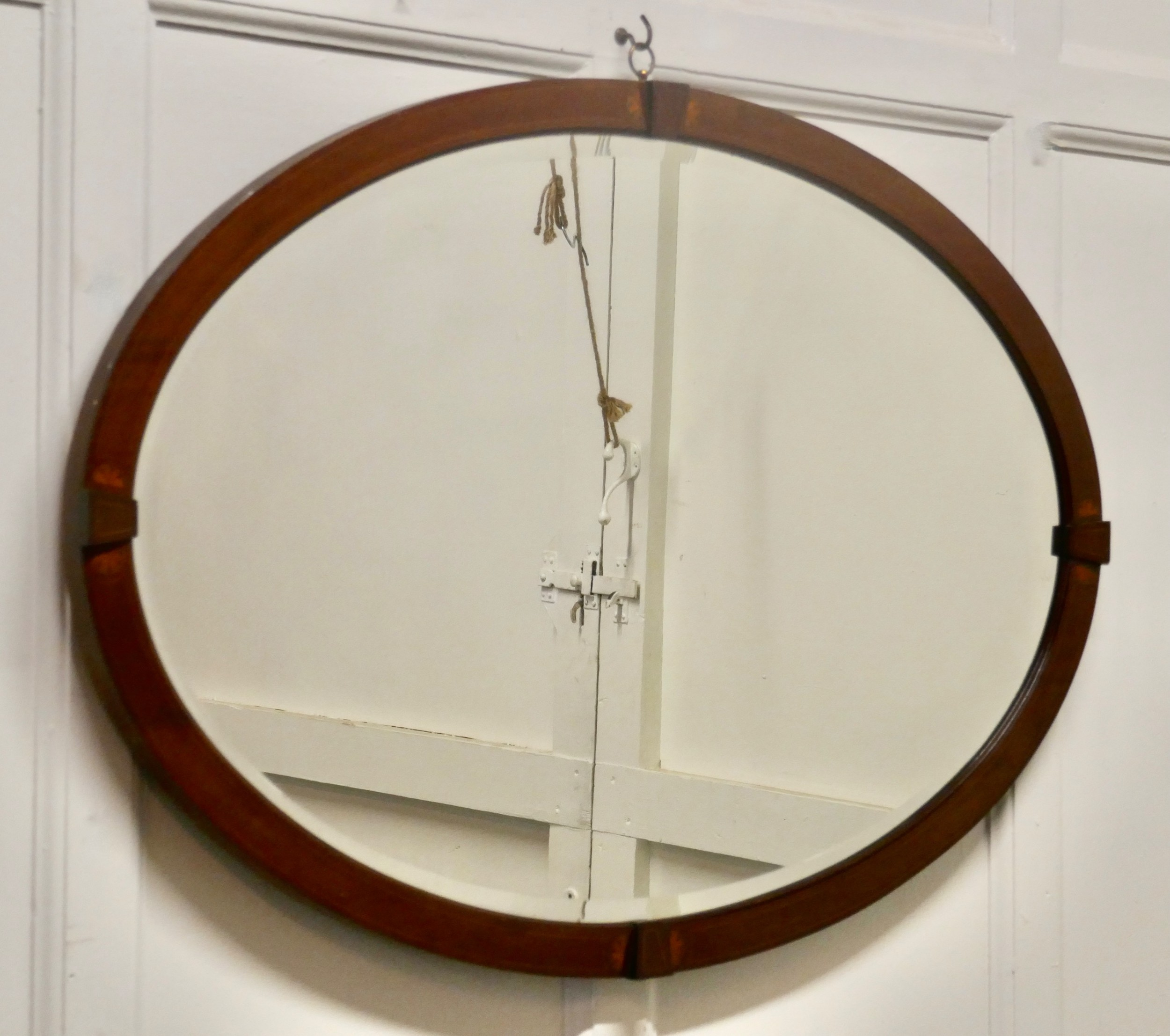 a large edwardian inlaid mahogany oval mirror