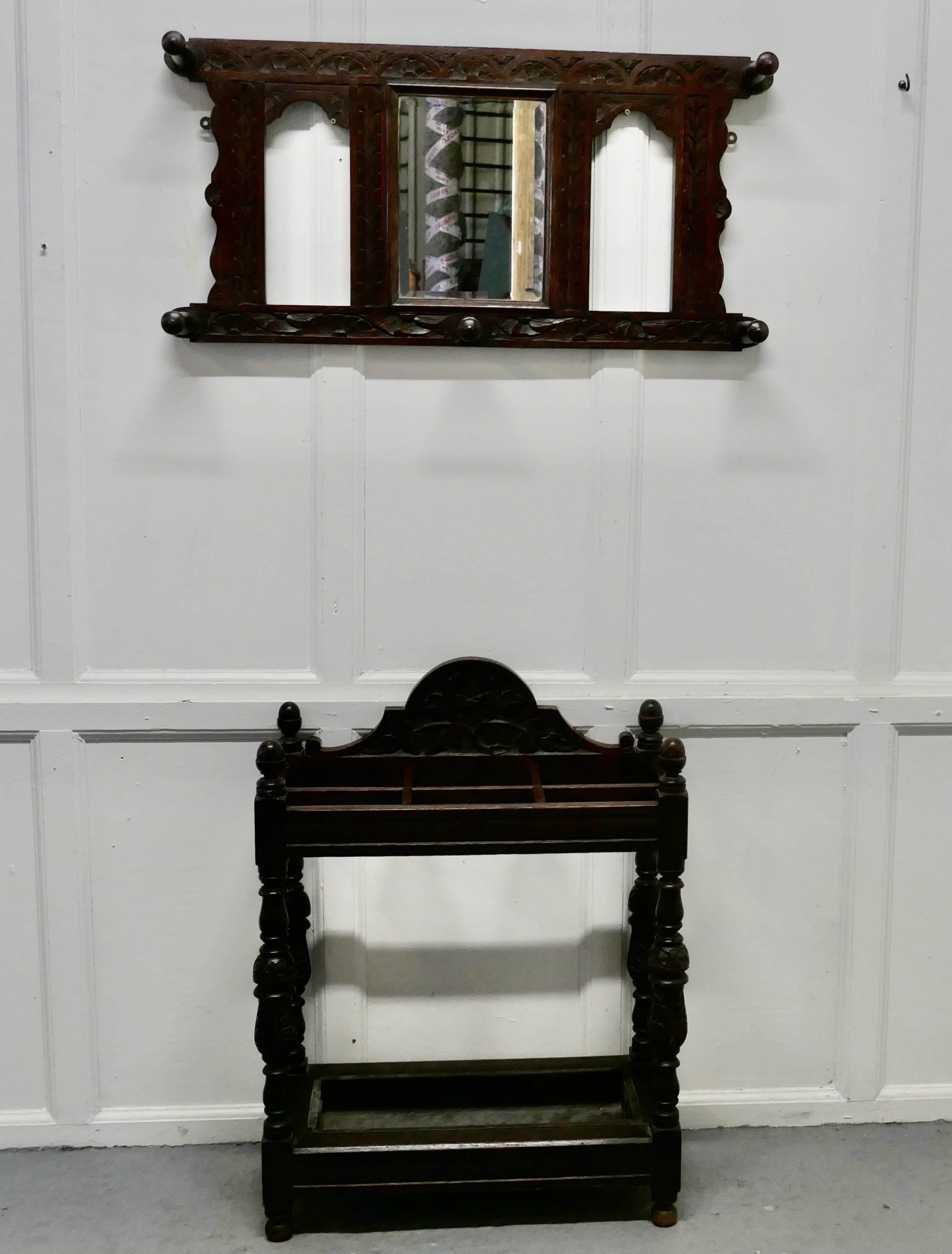a victorian carved oak stick stand matching mirror set