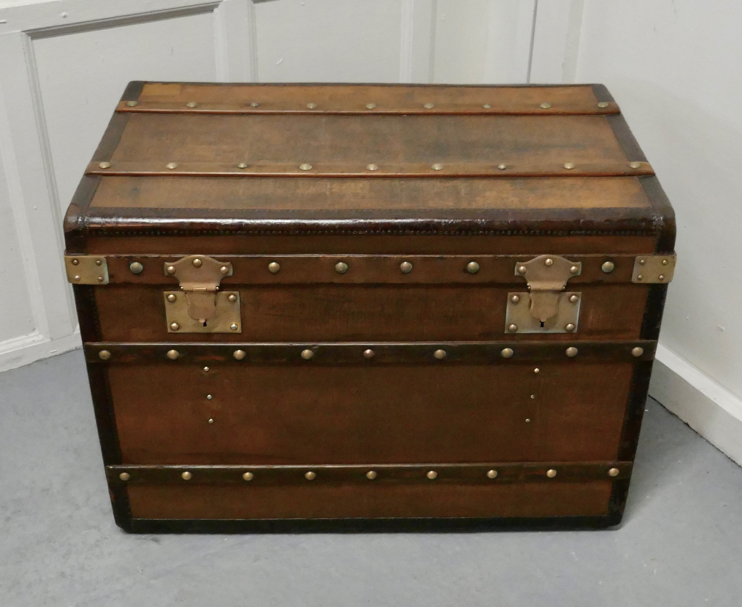 large tan canvas wood leather and brass bound steamer trunk