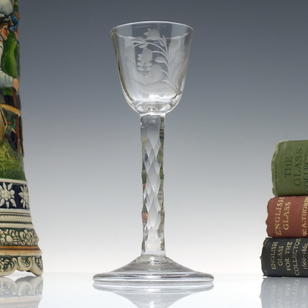 rare facet cut engraved wine glass with folded foot c1750