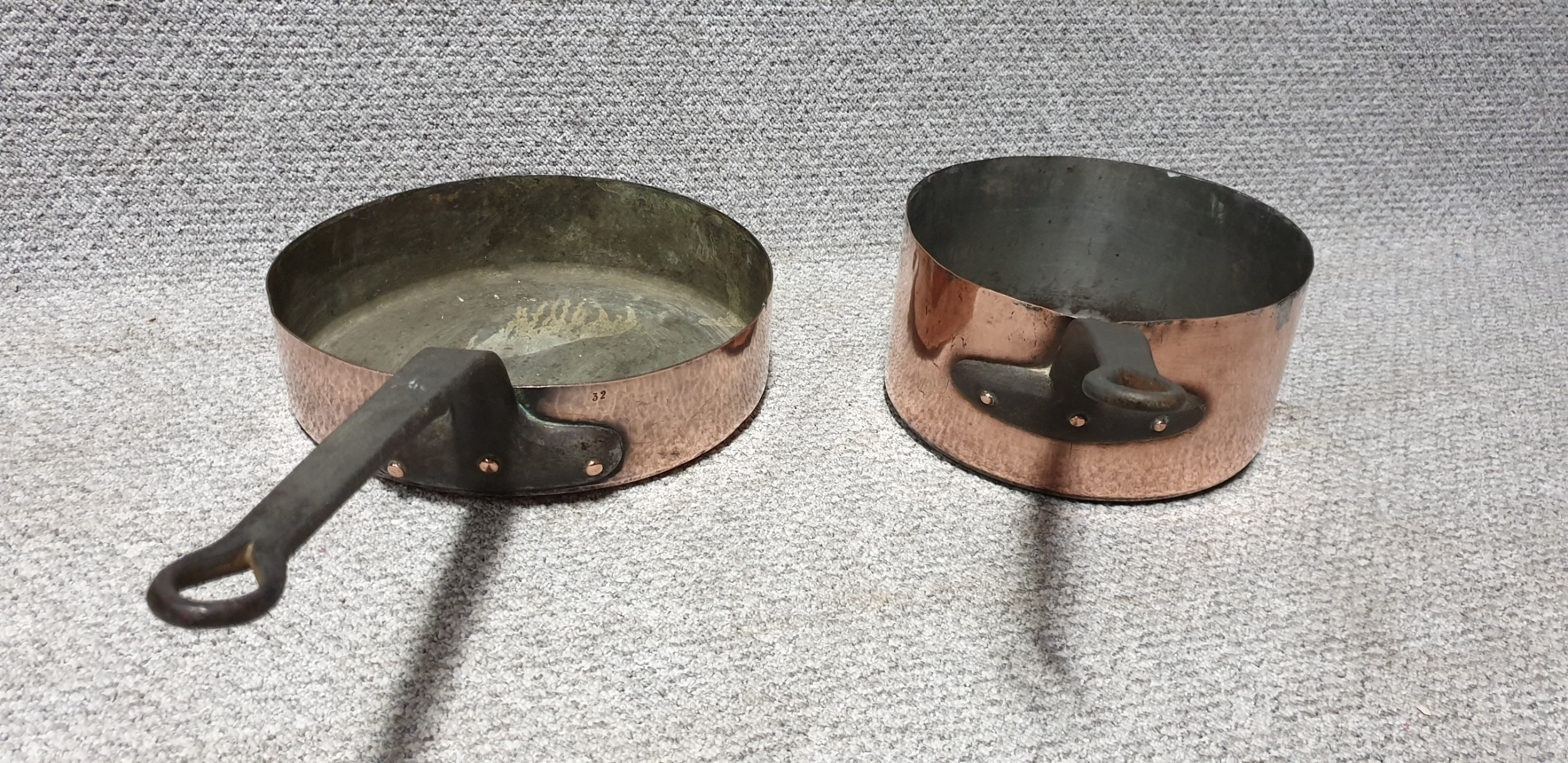 two large copper pans
