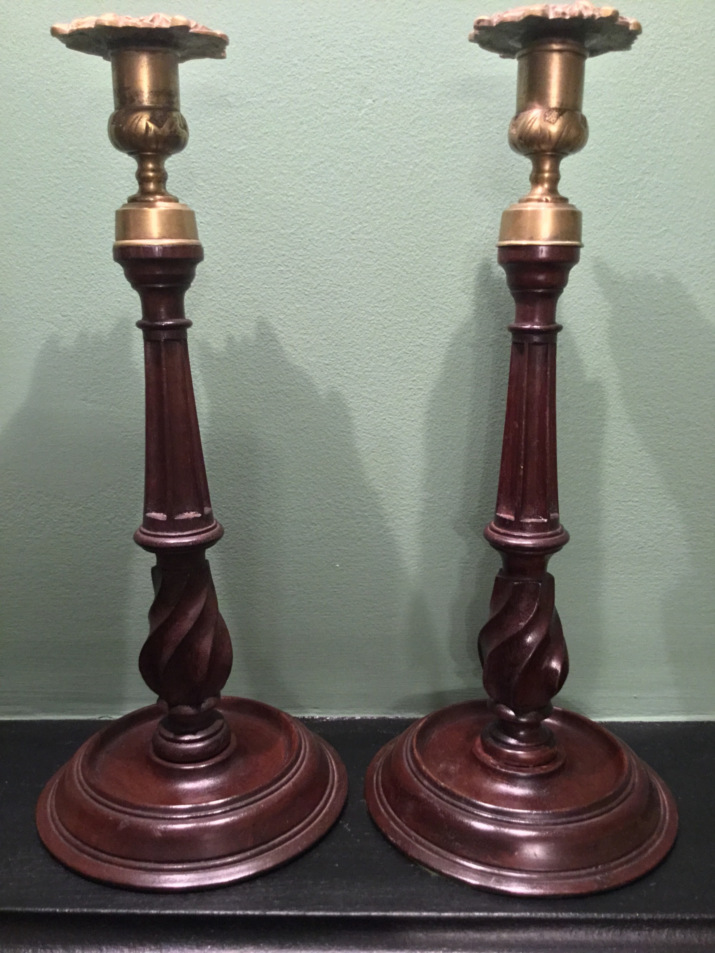 a pair of 19th century mahogany and brass candlesticks