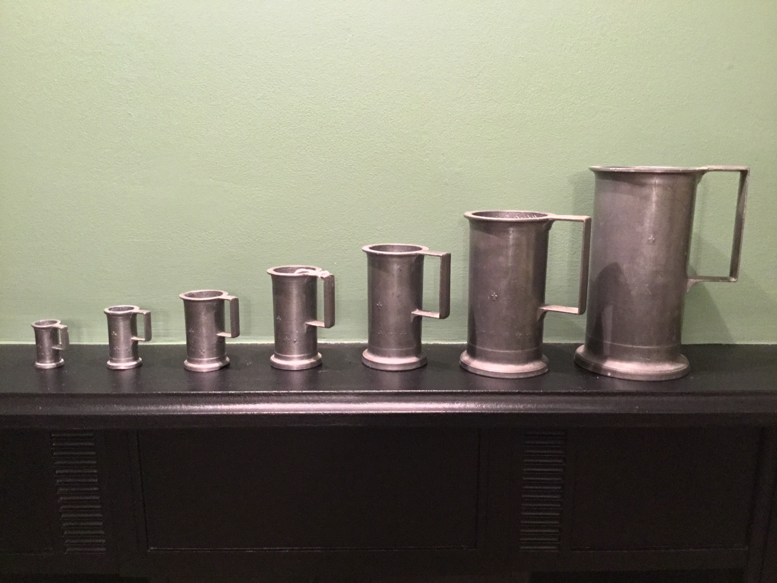 a set of seven 19th century french pewter measures