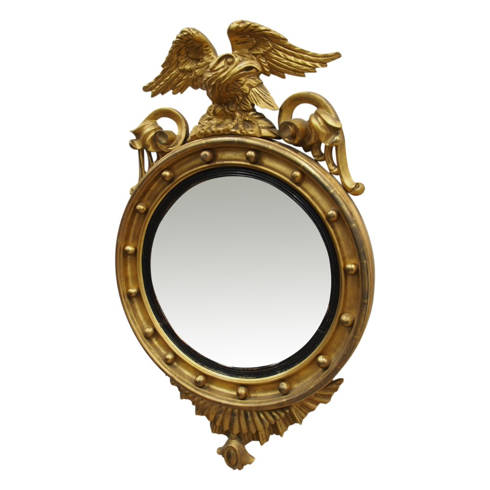 regency style carved giltwood convex mirror