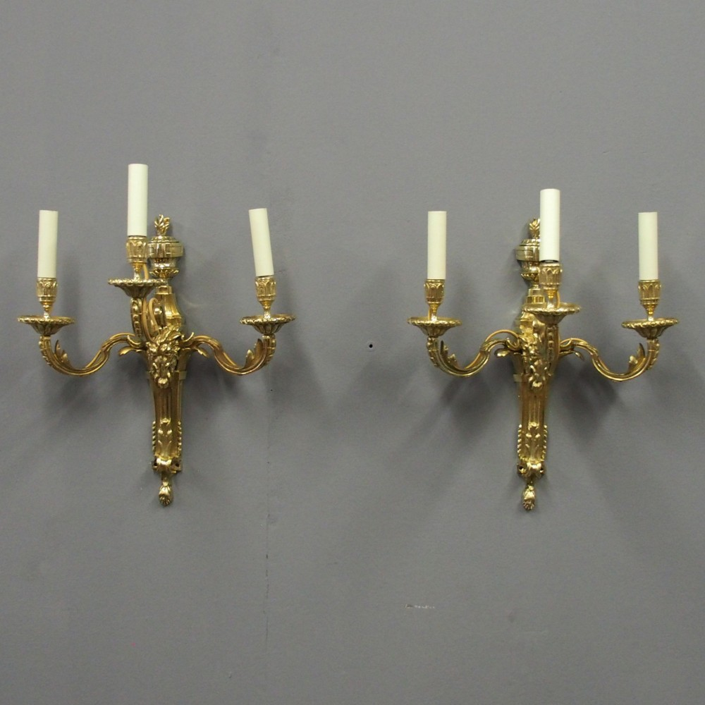 pair of adams style cast brass and gilded wall sconces