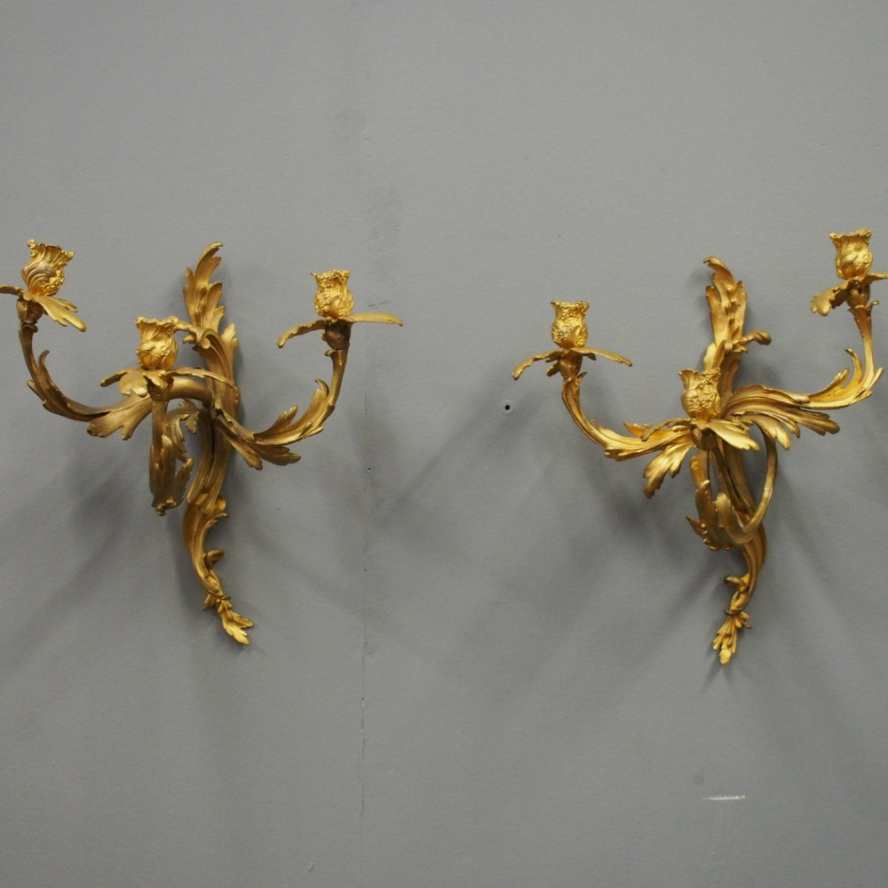 pair of louis xv style cast brass and gilded sconces