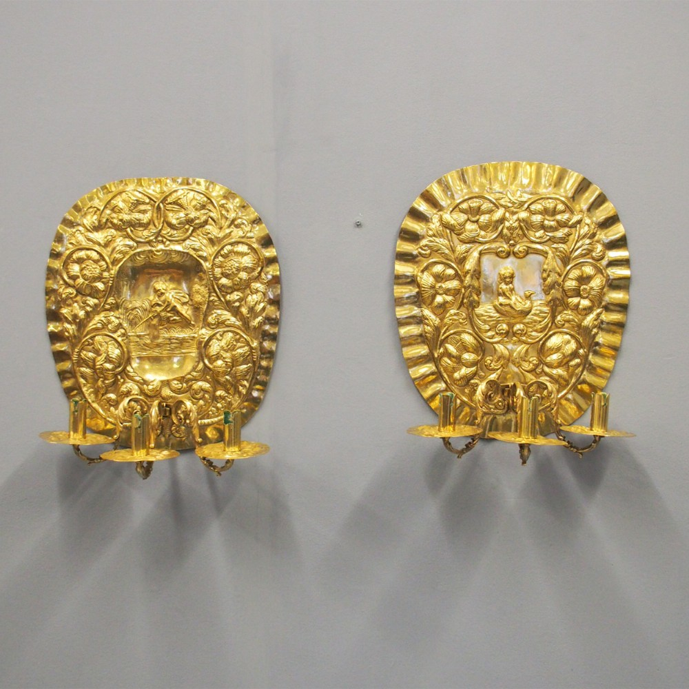 pair of large embossed brass sconces