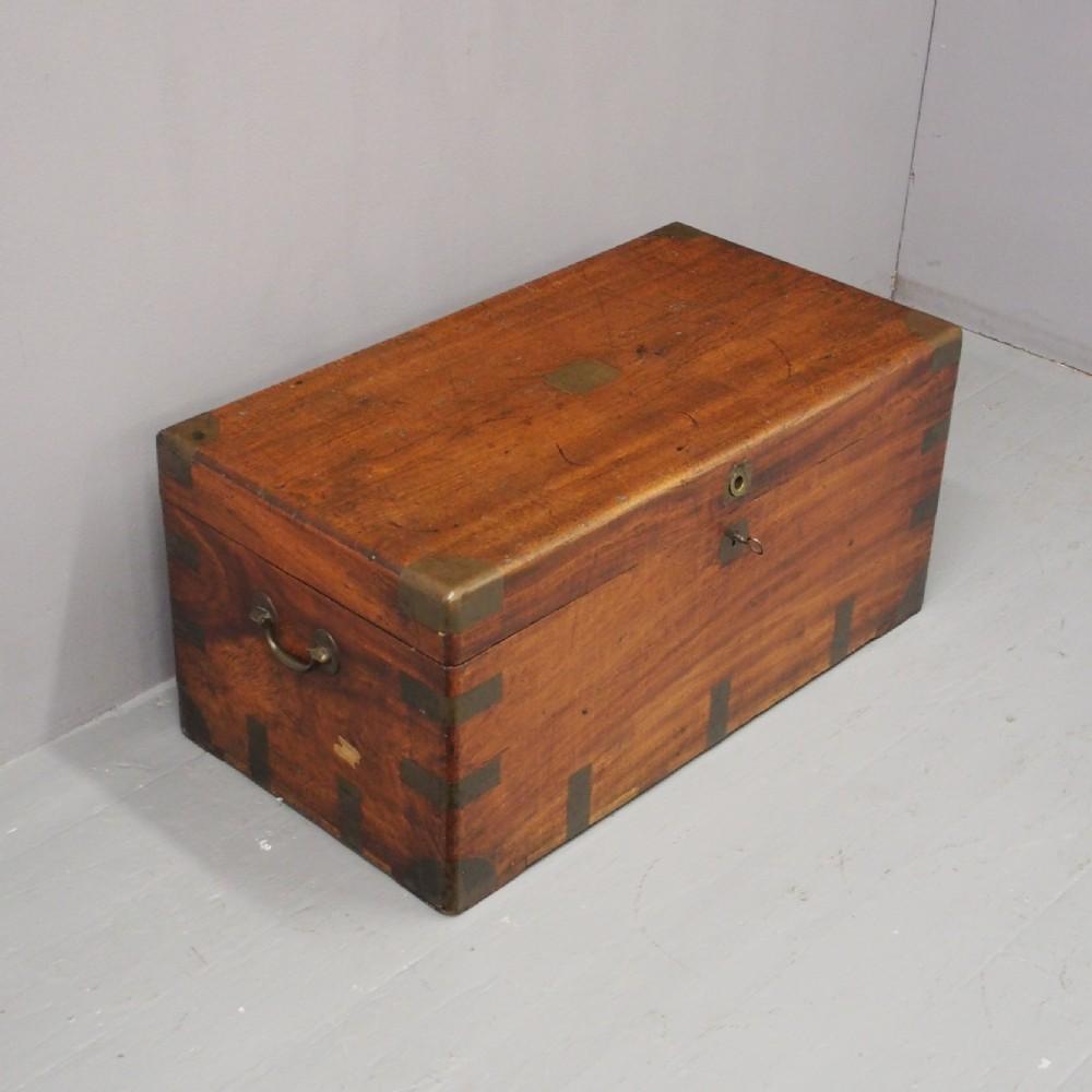 brass bound camphor wood trunk