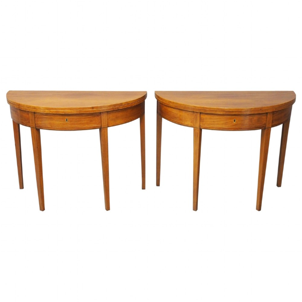 pair of george iii mahogany fold over tea tables