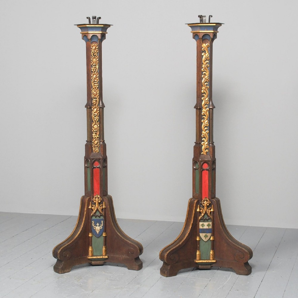 pair of gothic revival oak standard lamps