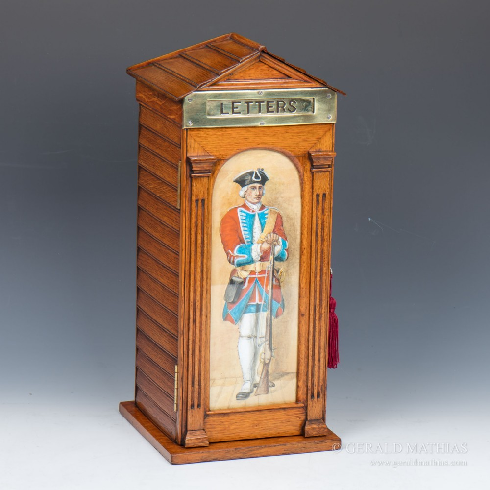 an edwardian oak post box in the form of a sentry box