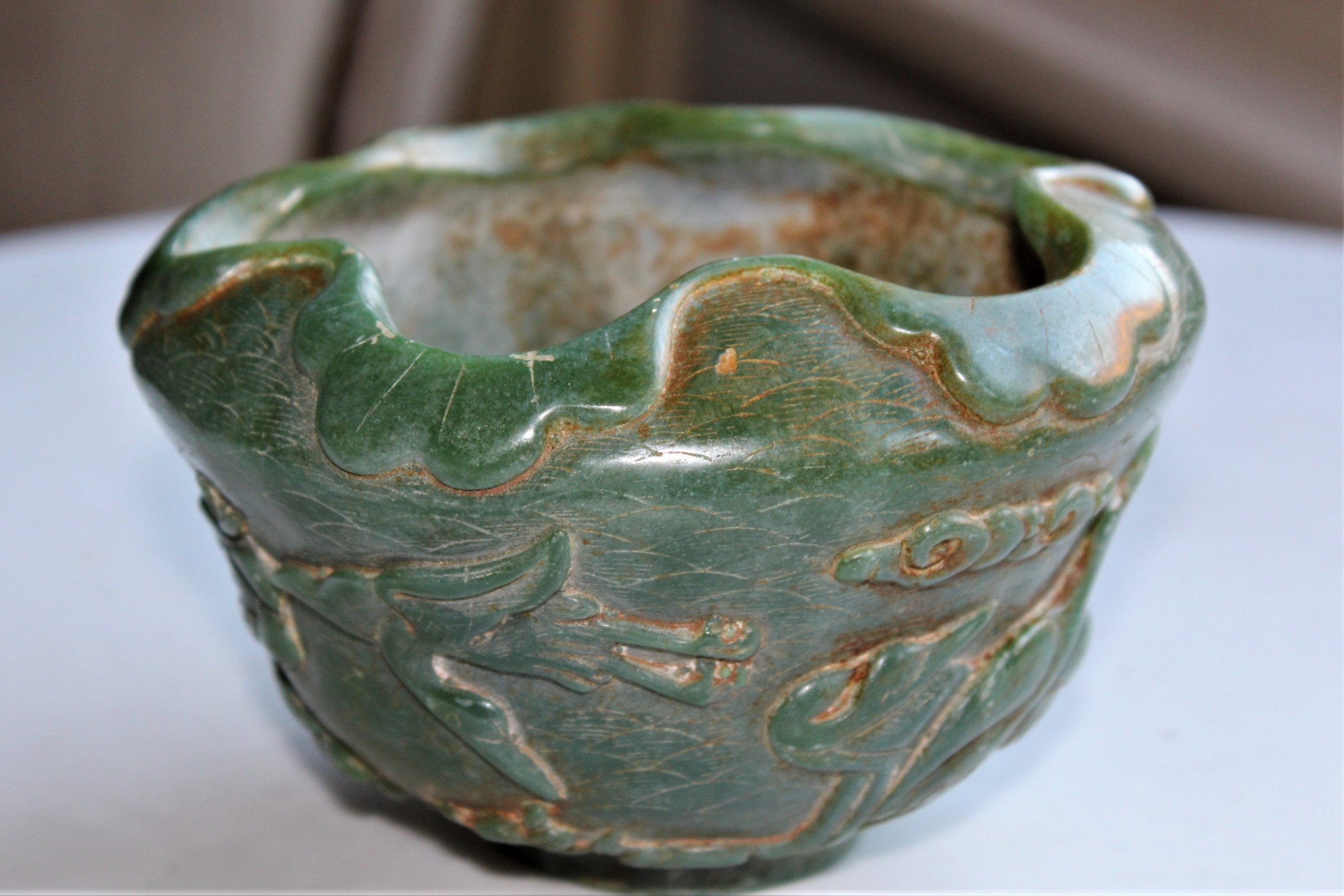 a very attractive chinese green jade bowl with decoration of cherry blossom and birds