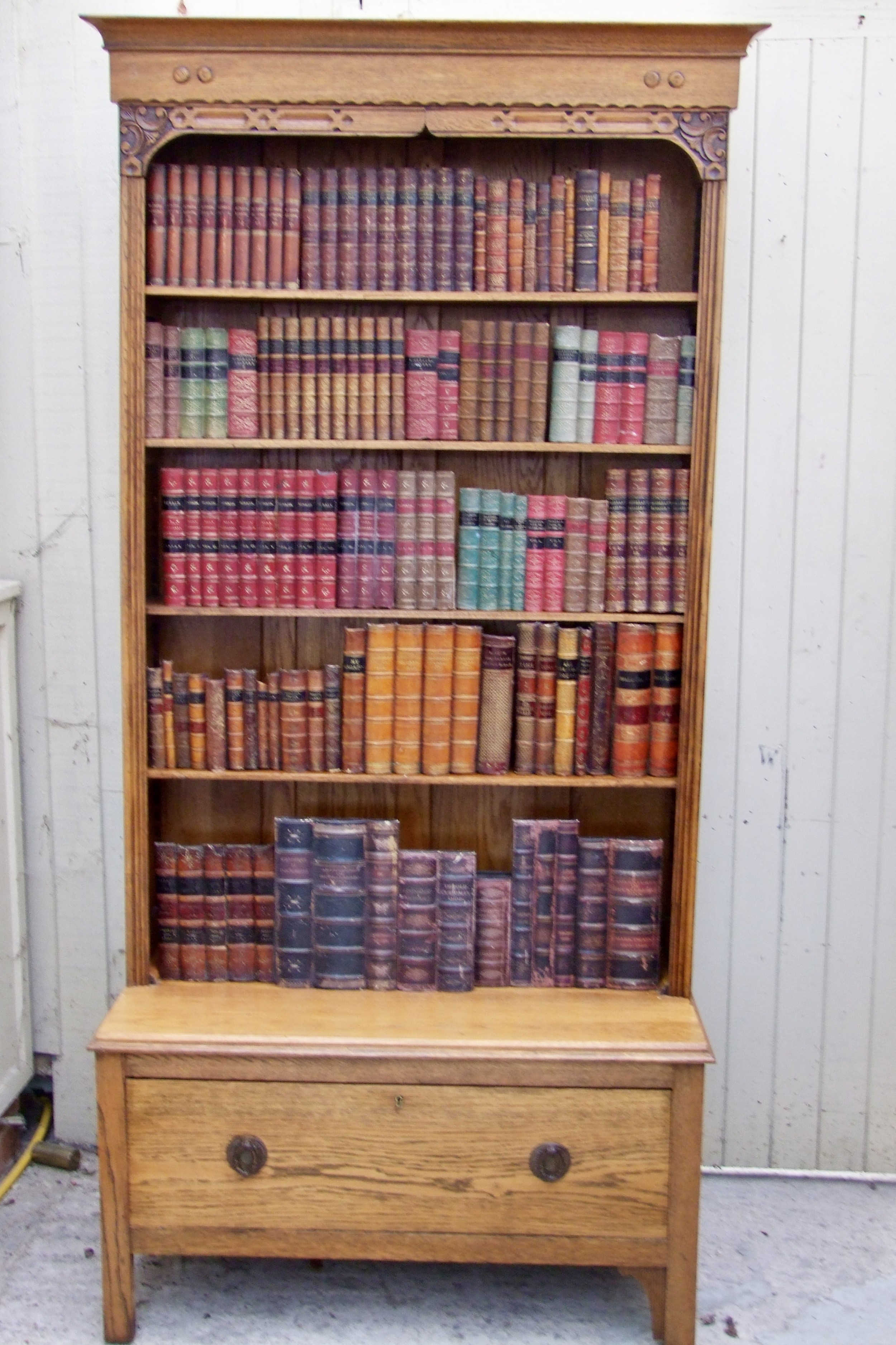 very good quality golden oak open bookcase with drawer under