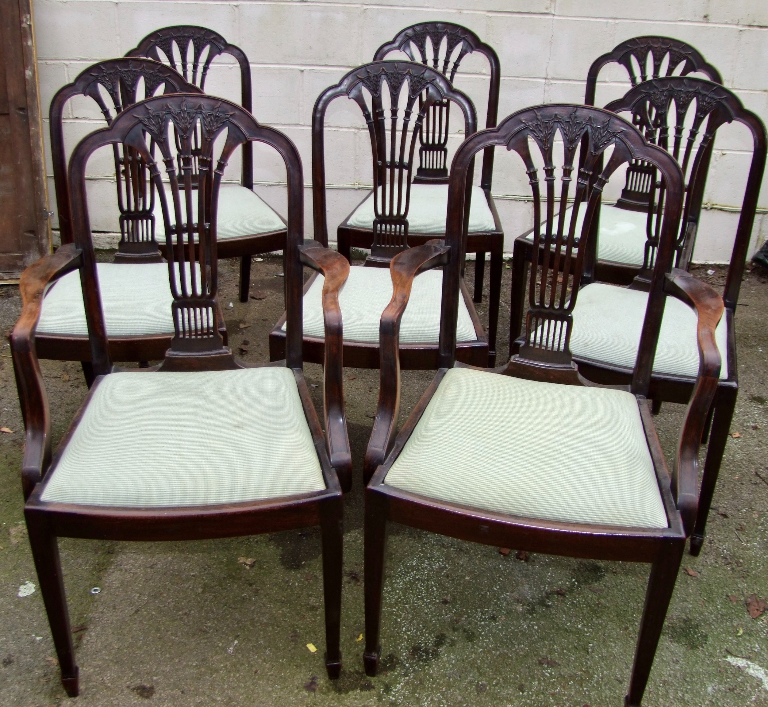 set of eight 19th century dining chairs by s h jewell of london two carvers and six singles in the hepplewhite style