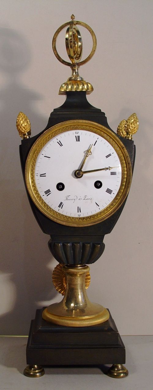 an early 18th cent french bronze and ormolu mantel clock