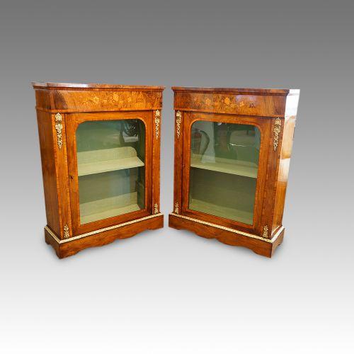 pair of victorian walnut pier cabinets