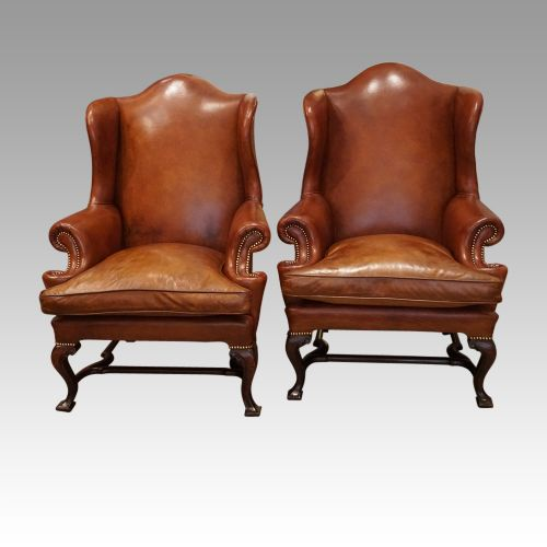 pair of georgian style leather wing chairs