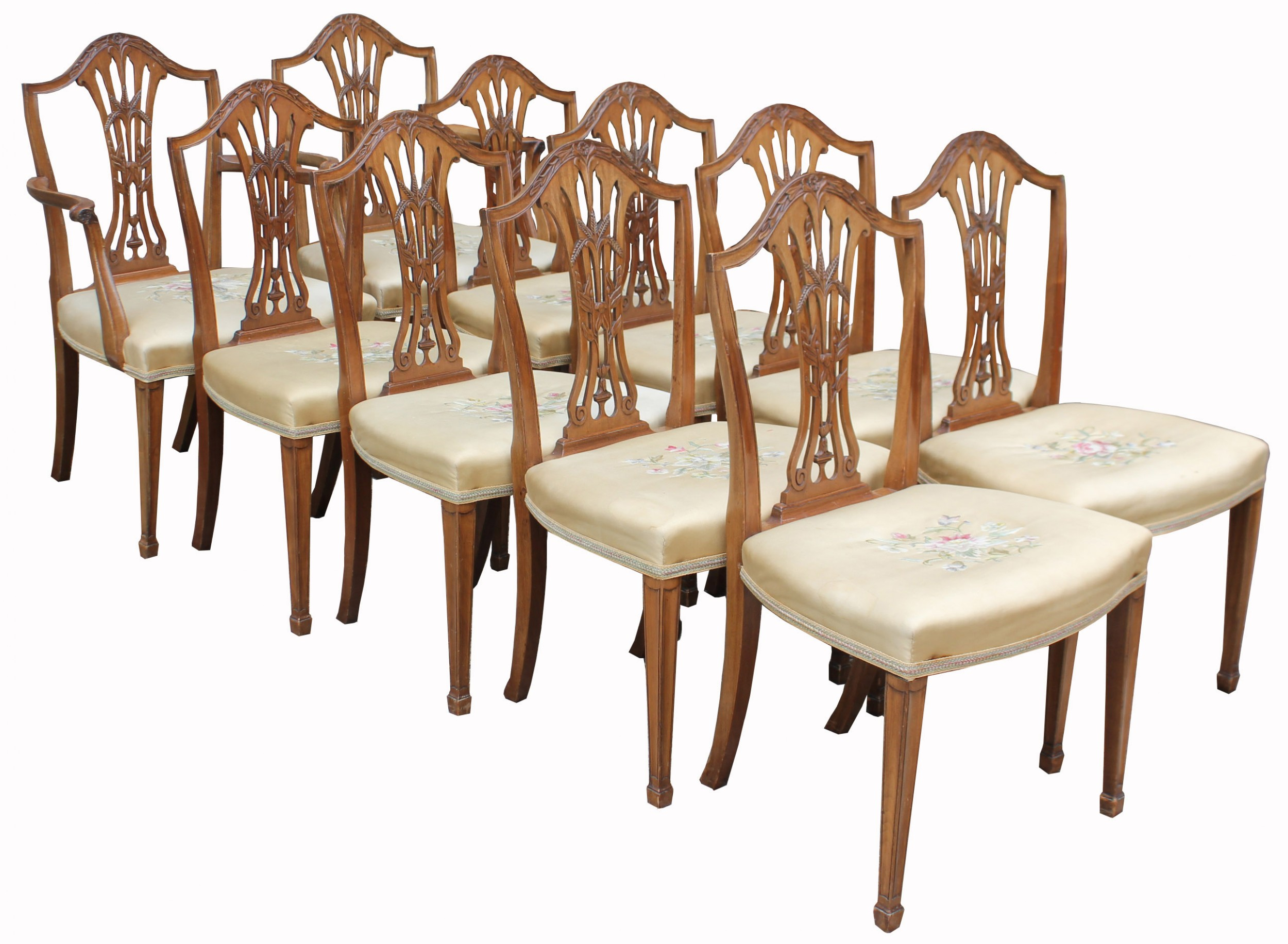 a lovely set of ten mahogany hepplewhite style dining chairs