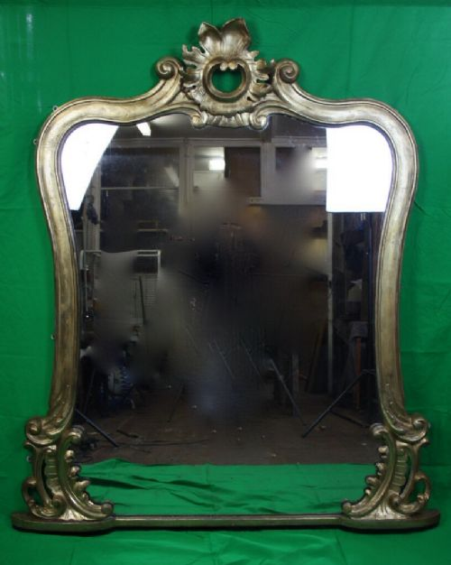 large carved gilt wood overmantel mirror