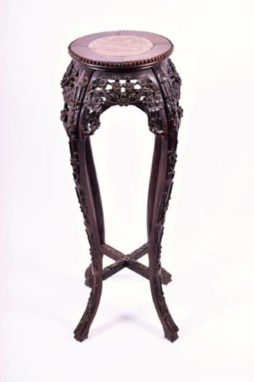 a chinese carved hardwood jardinaire stand