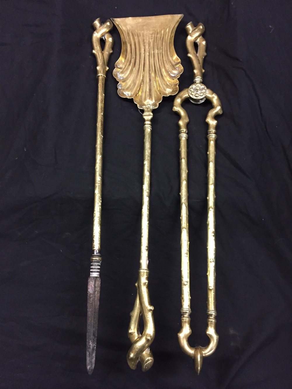 fine set of brass fire irons of naturalistic form