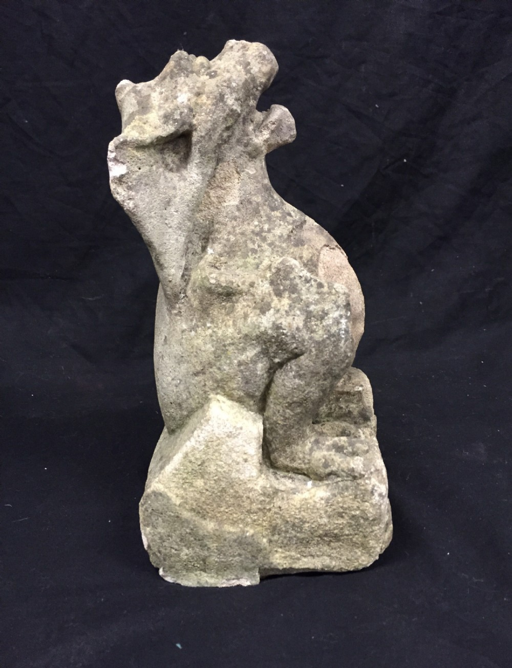 carved stone griffin gargoyle